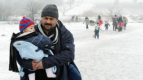 פליטים סורים בגבול נורבגיה - רוסיה, צילום: אי פי איי