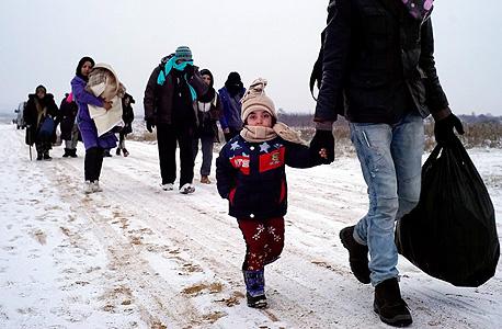 פליטים ליד הגבול, צילום: אימג