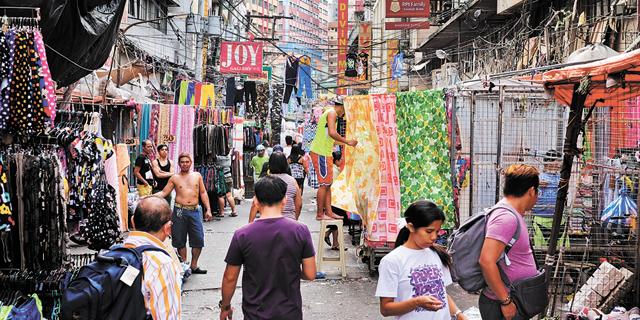 מניילה, בירת הפיליפינים. תיפגע במיוחד, צילום: בלומברג