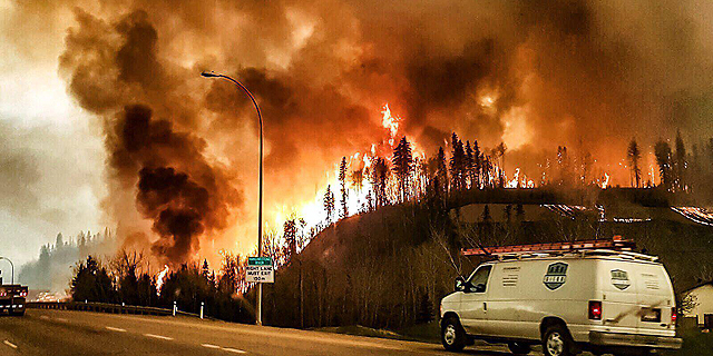 שריפת הענק בקנדה, בשבוע שעבר, צילום: אי פי איי