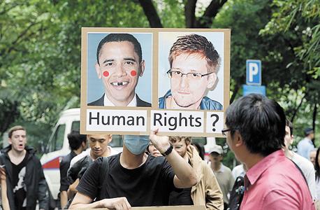 הפגנת תמיכה בסנודן בהונג קונג. יריית הפתיחה של התודעה הציבורית בנושא, איור: גטי אימג