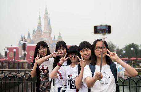 פרק שעשועים דיסני שנגחאי סין פתיחה 3, צילום: איי אף פי