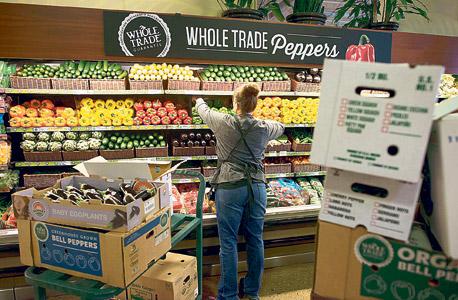 סניף של ענקית המזון האורגני Whole Foods. הפכה את Instacart לאפליקציית המשלוחים הרשמית, צילום: בלומברג
