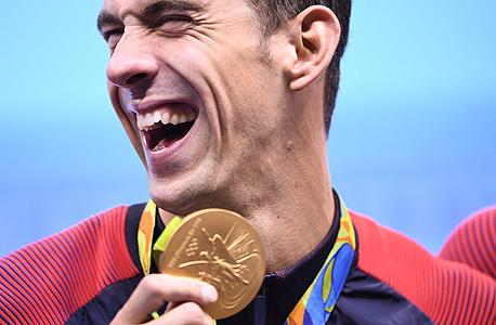 אולם לא כל זוכי המדליות יהיו פטורים מהמס. ספורטאים המרוויחים מעל מיליון דולר בשנה, כמו השחיין מייקל פלפס, עדיין יצטרכו לשלם מס. , צילום: איי אף פי