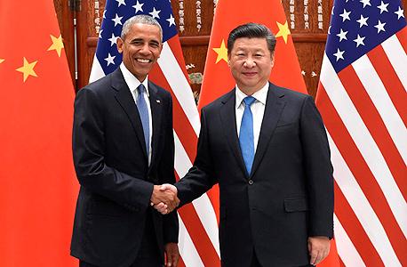 """מימין נשיא סין שי ג'ינגפינג ו נשיא ארה""""ב ברק אובמה., צילום: איי פי"""