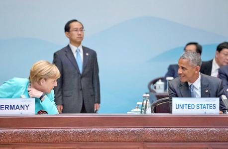 ברק אובמה ו אנגלה מרקל אתמול בסין, צילום: אי פי איי