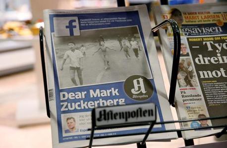 מאמר באחד העיתונים בנורבגיה הקורא לפייסבוק שלא לצנזר את התמונה, צילום: רויטרס