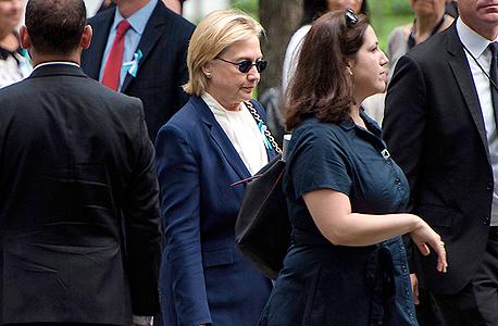 הילארי קלינטון עוזבת את הטקס לזכר פיגוע התאומים לפי פרסום בפוקס היא התעלפה, צילום: איי אף פי