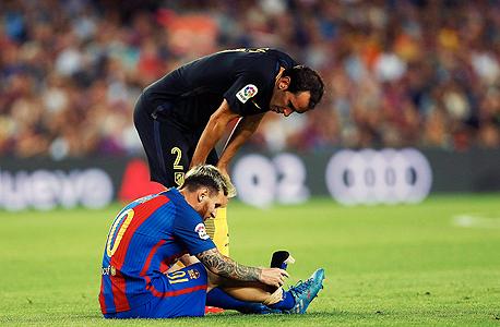 ליאו מסי פצוע, צילום: אי פי איי