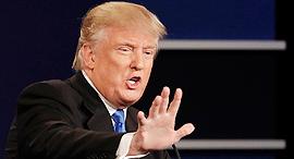 דונלד טראמפ בעימות מול הילרי, צילום: איי פי