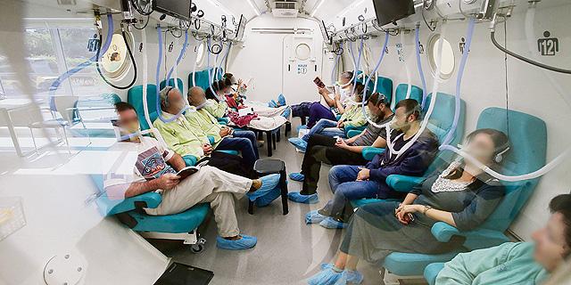 מטופלים בתא לחץ (למצולמים אין קשר לכתבה), צילום: שאול גולן