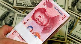 כסף דולרים יואן סין  , צילום: csmonitor.com