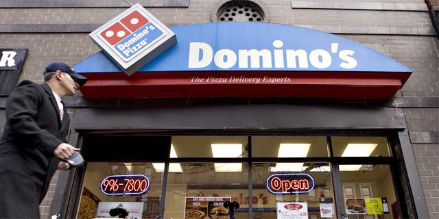 בלי תוספות: המשקיעים חוששים שדומינו'ס פיצה מיצתה את הצמיחה שלה בבריטניה