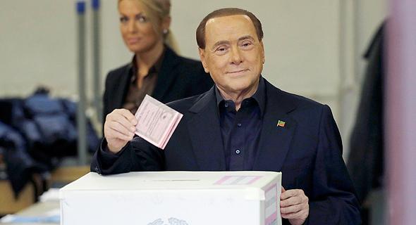 ראש ממשלת איטליה לשעבר, סילביו ברלוסקוני, מצביע הבוקר ברומא, צילום: איי פי