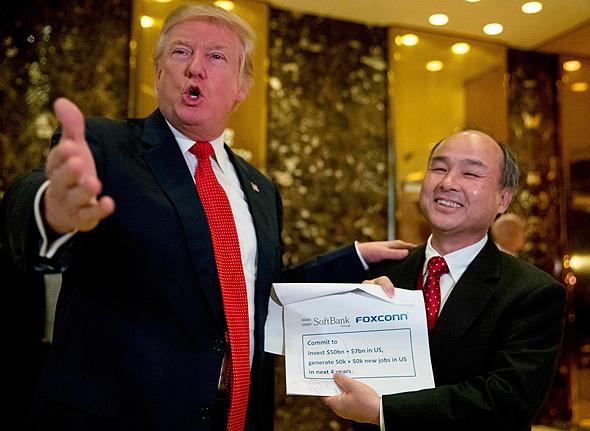 דונלד טראמפ ו מאסאיושי סון, צילום: איי פי