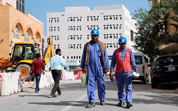 עובדים בקטאר