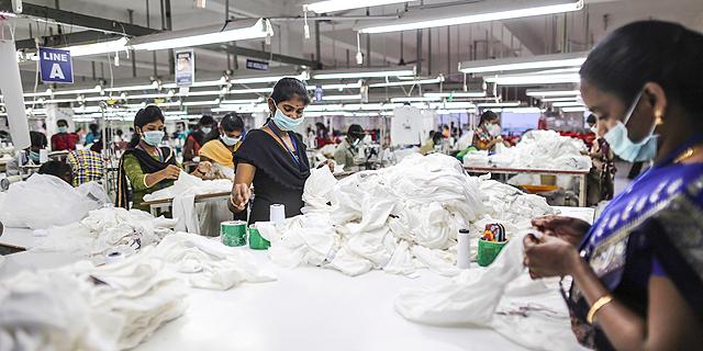 מפעל טקסטיל בהודו, צילום: בלומברג