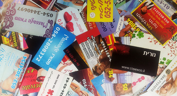 Business cards advertising escort services in Israel. Photo: Shaul Golan: