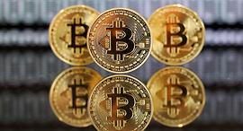 מטבע ביטקוין וירטואלי, צילום: בלומברג