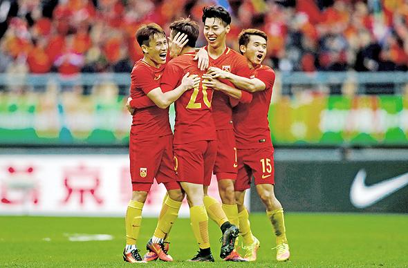 שחקני נבחרת סין בכדורגל, צילום: איי אף פי