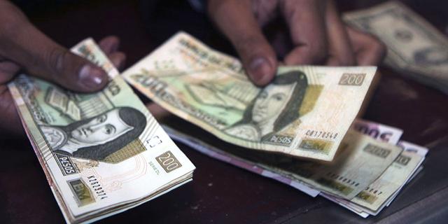 כסף מקסיקני מקסיקו פזו פזוס שטרות, צילום: בלומברג