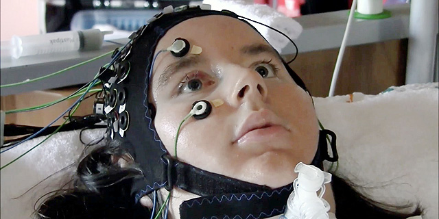 A person suffering from ALS hooked up to brain monitors to help them communicate