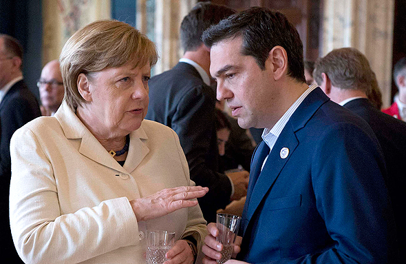 ראש ממשלת יוון אלכסיס ציפרס עם קאנצלרית גרמניה אנגלה מרקל