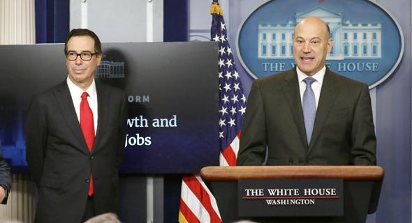 מסיבת העיתונאים של מנושין וקוהן, שבה הוצגה רפורמת המס, צילום: רויטרס