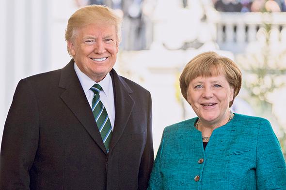 רונלד טראמפ עם אנגלה מרקל, צילום בלומברג