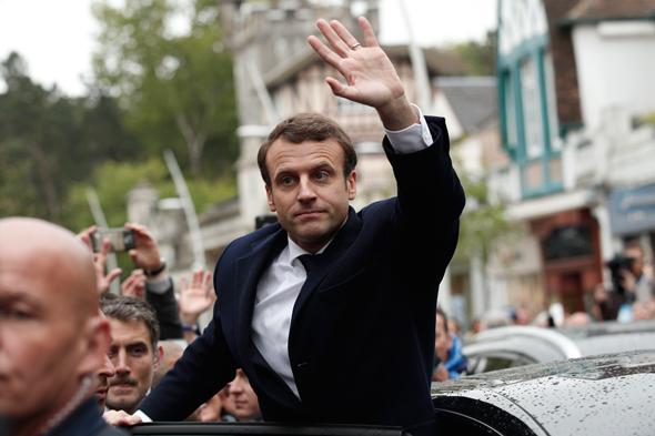 עמנואל מקרון ביום ההצבעה ב סיבוב ה שני ל בחירות ב צרפת , צילום: אי פי איי