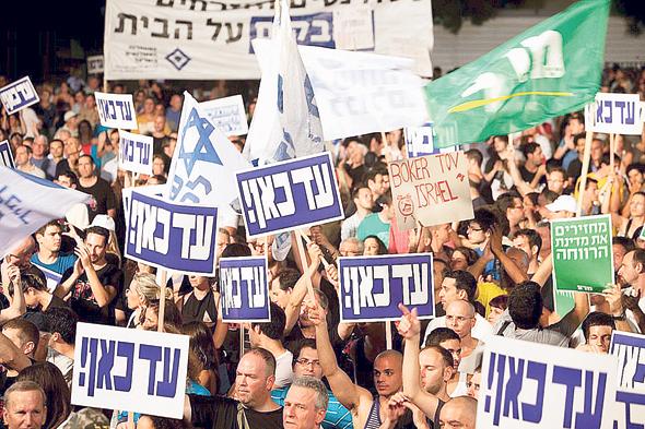 """הפגנה נגד יוקר המחיה ב־2011. """"אנחנו עושים הרבה להורדת יוקר המחיה"""""""