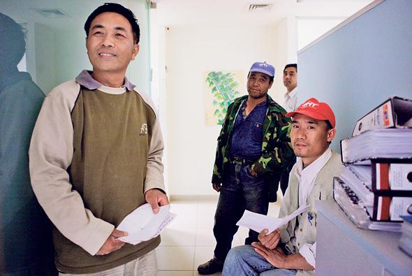 עובדי בניין סינים בישראל, צילום: תומי הרפז