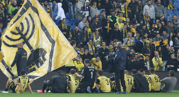 Beitar Jerusalem fans and team members. Photo: Reuven Schwartz