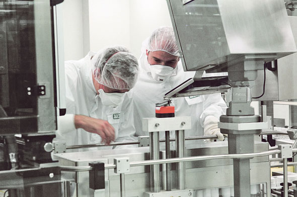 Workers at a Teva laboratory