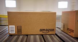 אמזון מסחר אלקטרוני אי-קומרס חבילות קניות, צילום: בלומברג