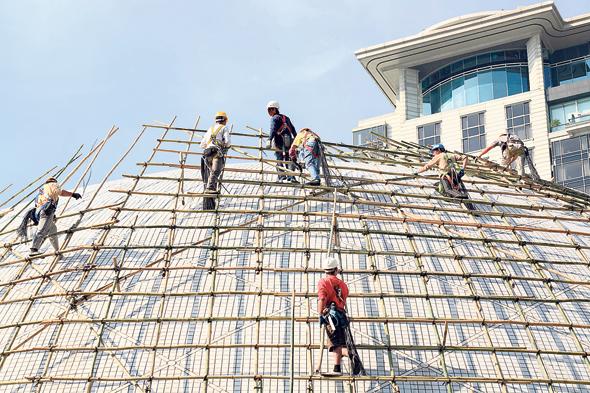 פועלי בניין סינים, צילום: שאטרסטוק