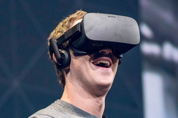 Facebook CEO Mark Zuckerberg with the Oculus headset