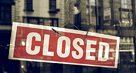 A closed for business sign. Photo: Shutterstock