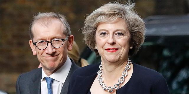 תרזה מיי, ראש ממשלת בריטניה ובעלה, פיליפ מנהל קשרי משקיעים, צילום: איי פי