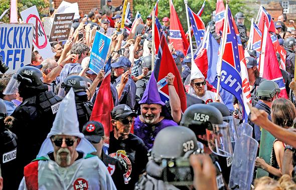 הפגנה של קו קלוקס קלאן החודש בווירג'יניה. כבר לא צריכים להסתתר