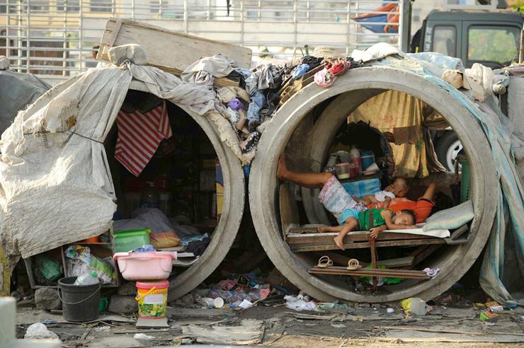 חסרי בית בפיליפינים, צילום:AFP