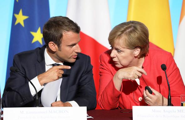 מימין: קנצלרית גרמניה אנגלה מרקל וראש ממשלת צרפת עמנואל מקרון