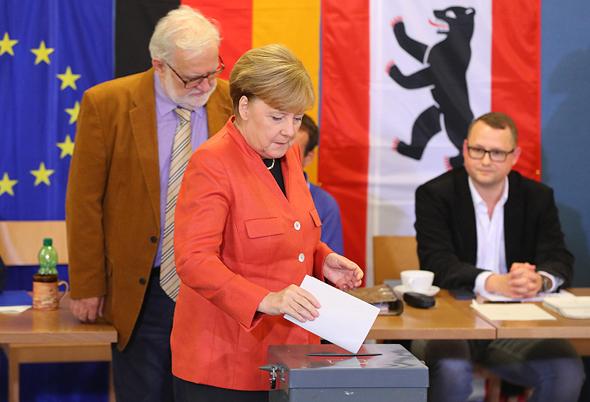 אנגלה מרקל מצביעה ב בחירות לפרלמנט ב גרמניה, צילום: איי פי