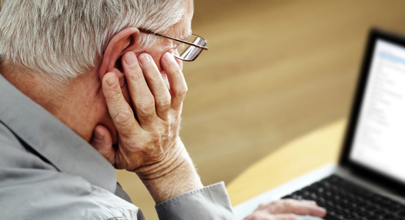 Elderly person using a computer (illustration). Photo: Shutterstock