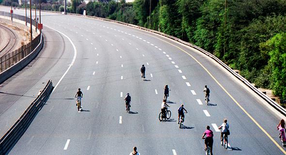 Bike riders on a highway in Israel