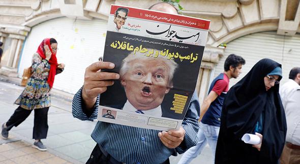 דונלד טראמפ על שער עיתון איראני, צילום: אי פי איי