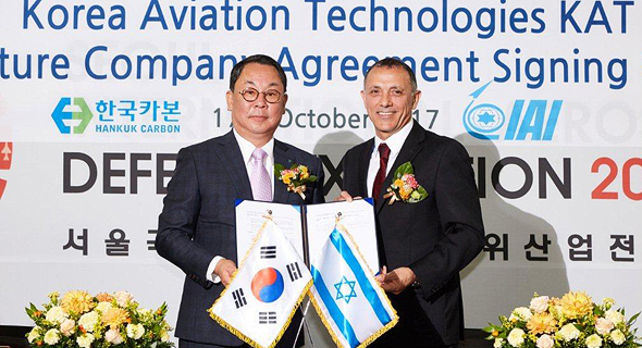 Hankuk Carbon CEO Moon-Soo Cho and Shaul Shahar, IAI Executive Vice President, sign joint venture agreement