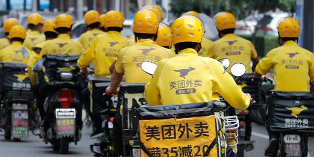 שליחים של חברת Meituan הסינית, צילום: Visual China
