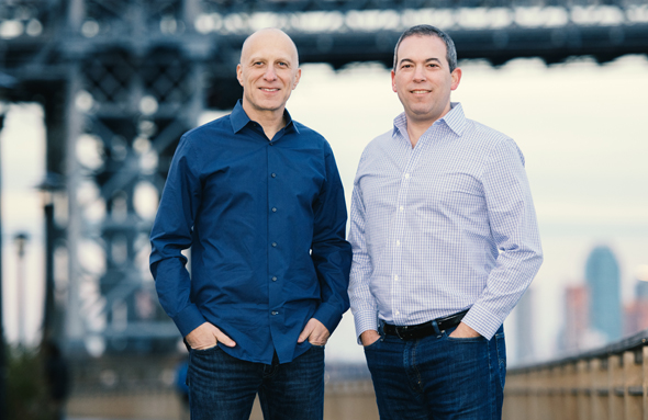 Outbrain co-CEOs David Kostman and Yaron Galai. Photo: Noam Galai