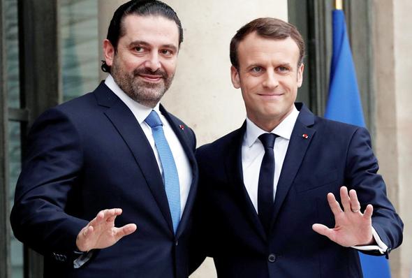 מימין נשיא צרפת עמנואל מקרון ו אל חרירי אתמול ב פריז, צילום: רויטרס